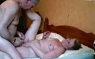 Mature couple kissing, masturbation, oral, missionary and cowgirl sex in the bedroom.