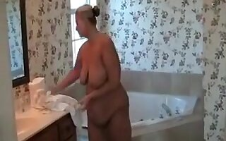 Spoiled BBW girl with huge saggy breasts licks her own nipples with passion