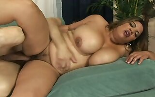 Chubby owner of really giant saggy boobies is fucked in sideways pose